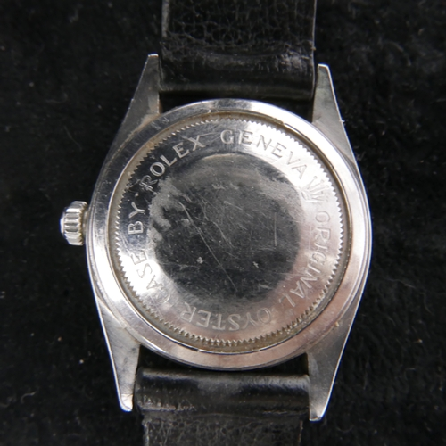48 - A Gentleman's Tudor wristwatch with chrome case, silvered dial and seld winding movement on a black ...