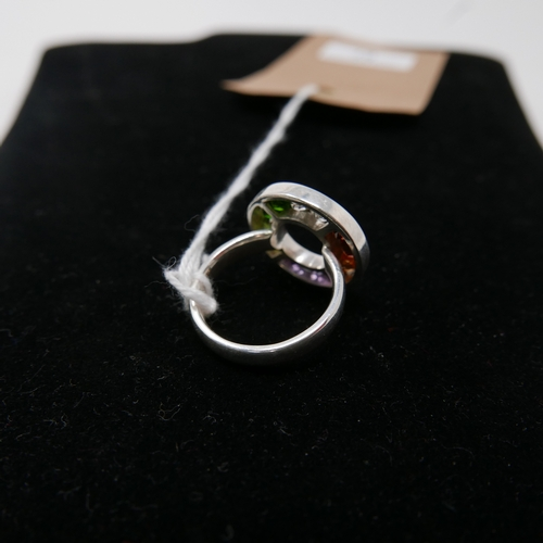 67 - A sterling silver circular ring set with round, faceted amethysts, citrines, garnets, crystals, gree...