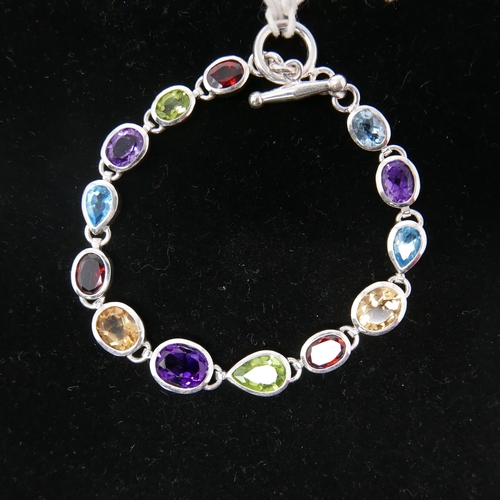 93 - A sterling silver and muti-gem set necklace set with faceted amethysts, peridot, garnet, citrine and...