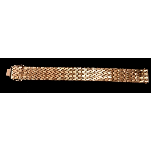 11 - WITHDRAWN - An 18ct yellow gold, textured mesh bracelet circa 1970's, L: 19.5cm, 62.6g. Stamped 750....