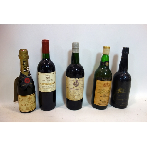 111 - Two vintage bottles of wine, two bottles of vintage sherry and a bottle of vintage champagne...