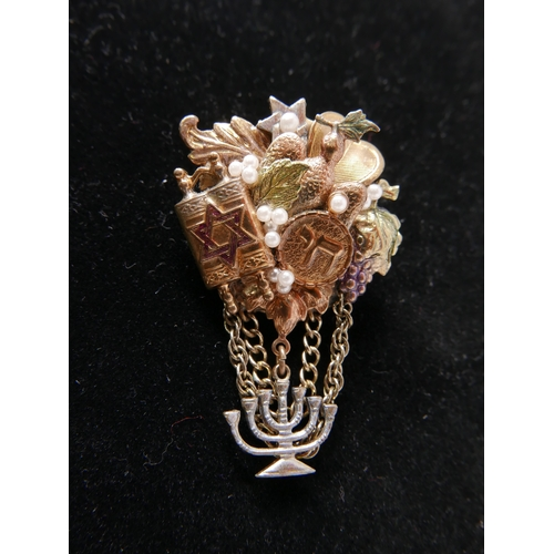 117 - A vintage, Judaic brooch in gilt metal studded with faux pearls and iconographic motifs suspended by...