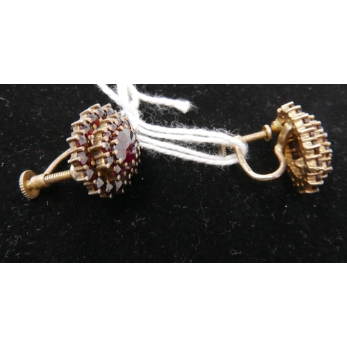 33 - A pair of antique, silver-gilt, garnet cluster screw-back earrings, Each stamped 'HGR, 830S', Cluste...