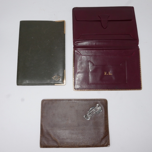 46 - 3 leather wallets to include a wine-red and gilt metal Cartier example 16.5 x 11xm Stamped 'Cartier,...