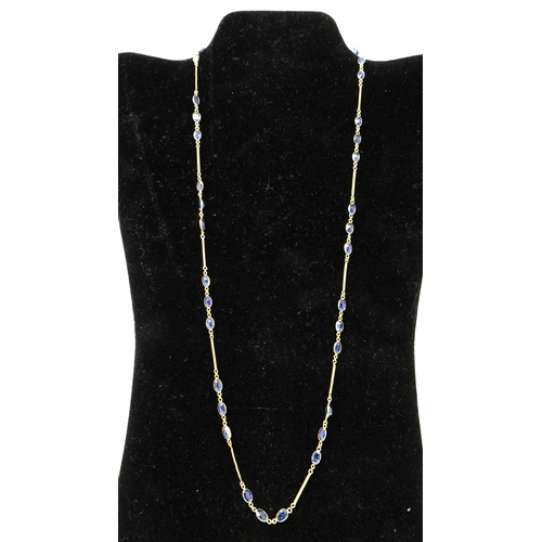 53 - A 14ct yellow gold chain necklace set with 33 faceted oval natural sapphires, L: 60cm, 6.7g...