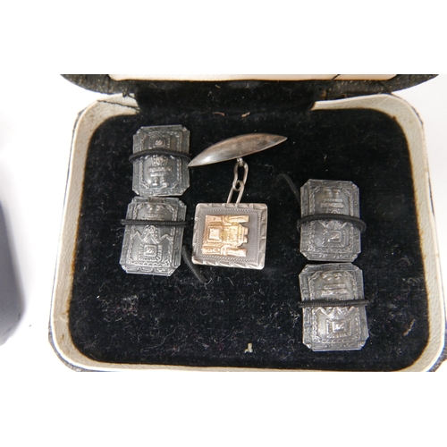 55 - Two leather boxes containing sterling silver cufflinks: 1 rectangular pair (17g) and 4 silver panels...