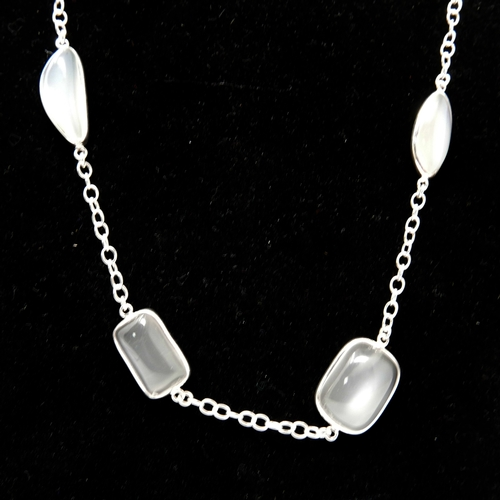 83 - A sterling silver long chain necklace of 2 metres set with 50 oval and pear-drop shaped moonstone ca...