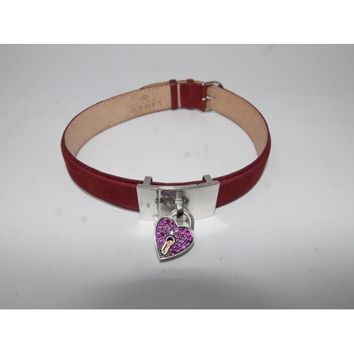 85 - A Links of London, wine-red leather choker with sterling silver and red crystal heart panel. All mar...