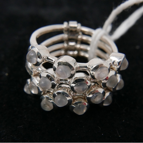 97 - A sterling silver 4-row stack ring set with 16 round cabochon moonstones, Size: Q, 10.2g....