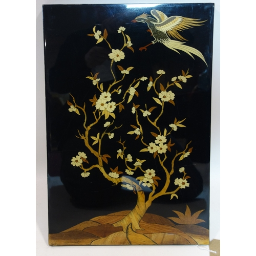 297 - A Persian lacquered wood panel, with marquetry decoration depicting an eagle by a tree, 57 x 34cm...
