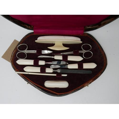 324 - A cased manicure set...