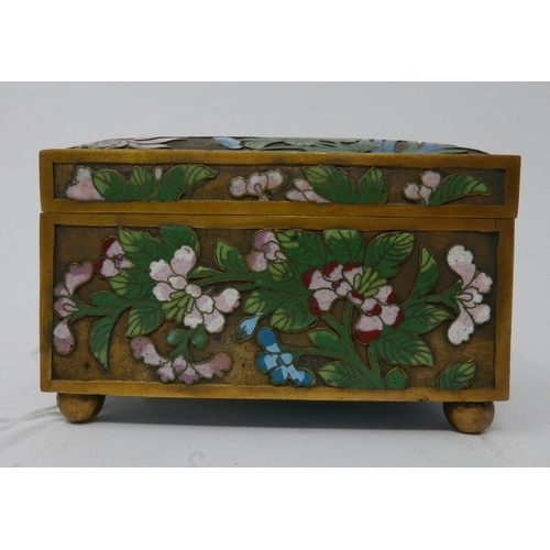342 - A Chinese brass and cloisonne enamelled box, decorated with blossoming flowers, with partial red wax...