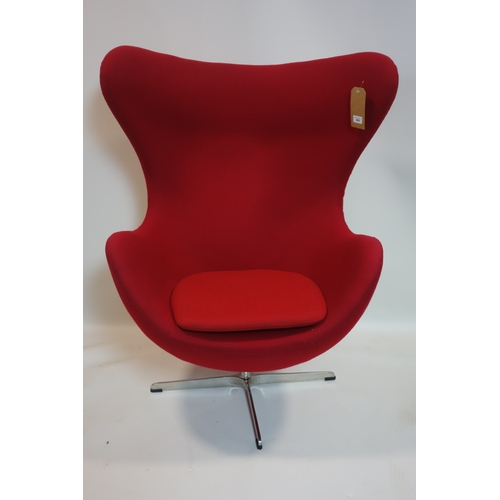 400 - An Arne Jacobsen style egg chair, stamped Fritz Hansen to base...