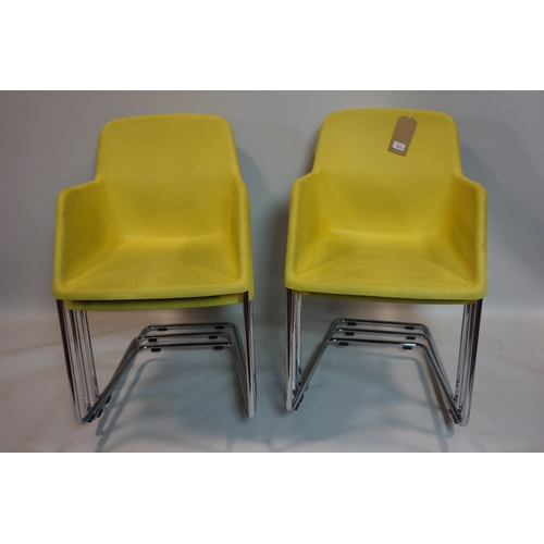 402 - A set of six contemporary yellow suede tub chairs on chrome supports...