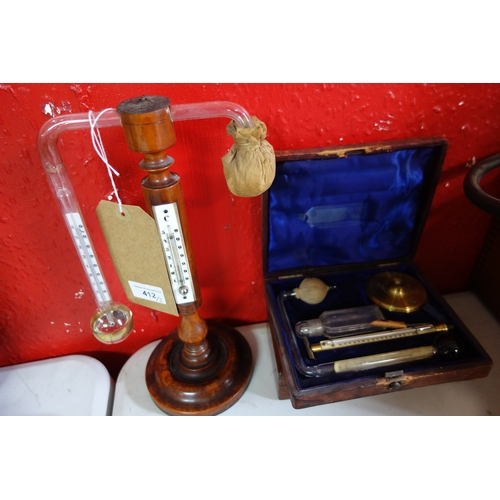 412 - A vintage Griffin & sons 'daniell's' hydrometer, with one other and a Sikes hydrometer...