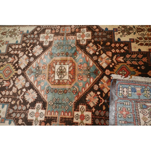 108 - A North West Persian Nahavand rug the central diamond medallion with repeating petal motifs, on a mi...