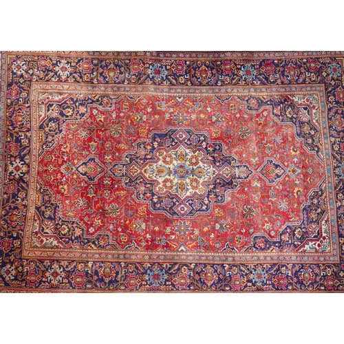 122 - A Central Persian Isfahan carpet the central double diamond pendant medallion with repeating spandre...