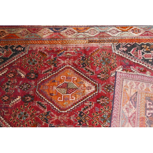 124 - A south west Persian Qashqai carpet the central diamond medallion with repeating petal motifs, on a ...