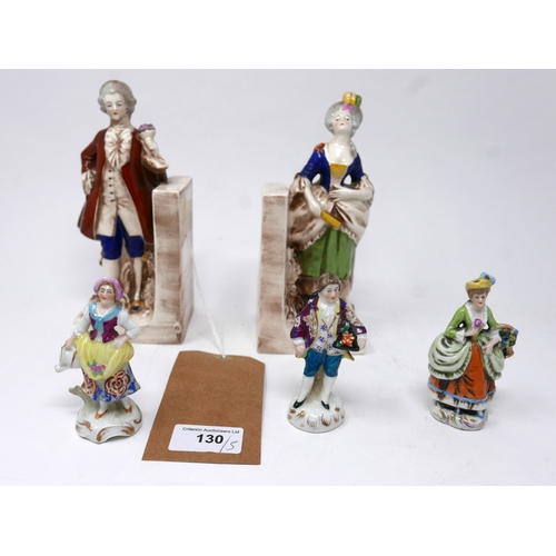 130 - A pair of porcelain bookends in the form a young couple, marked to bases, H.19cm, together with thre...
