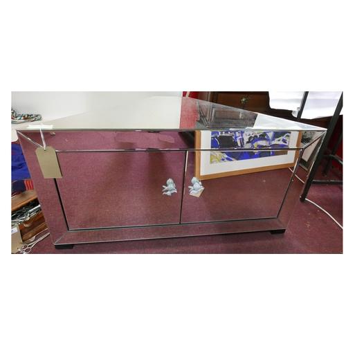 332 - A contemporary mirrored corner unit, H.56 W.109 D.47cm...