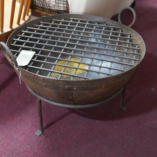 364 - A contemporary Kadai fire pit, with grill, on stand, Diameter 60cm...