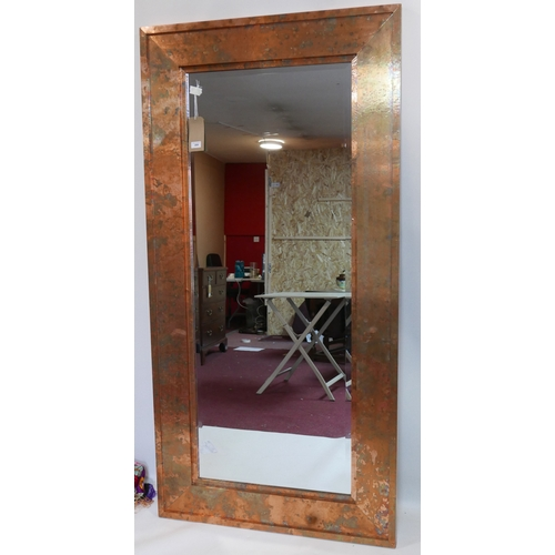 384 - A large contemporary rectangular copper mirror, with bevelled plate, 180 x 90cm...