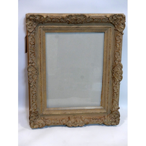 392 - An ornate part gilt wood picture frame, 72 x 59cm...