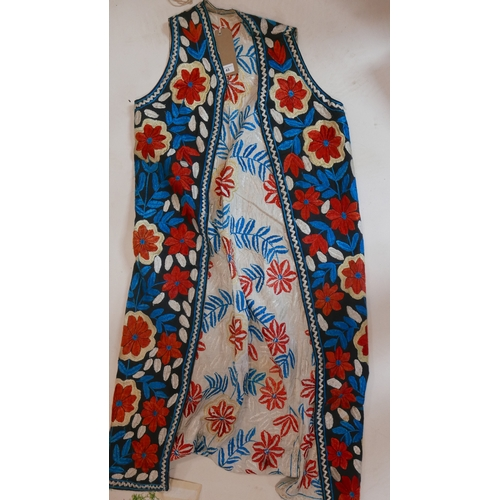 43 - An antique Suzani silk robe, polychrome decorated with flowers, H.130cm...