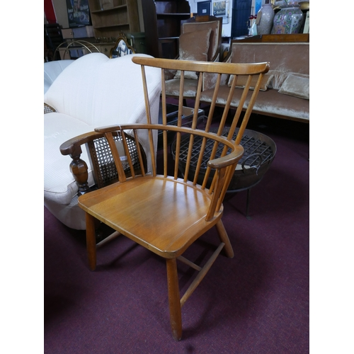 337 - A pair of beech wood Windsor armchairs...