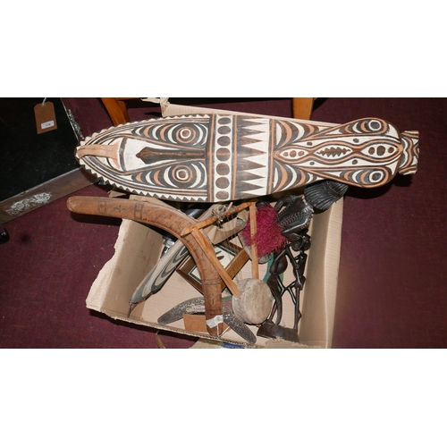403 - A collection of tribal art, to include two Papua New Guinean masks, two Australian boomerangs, two A...