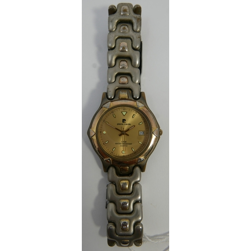 30 - A Pierre Cardin gentleman's wristwatch, gilt dial with baton markers, date aperture at three, on bra...