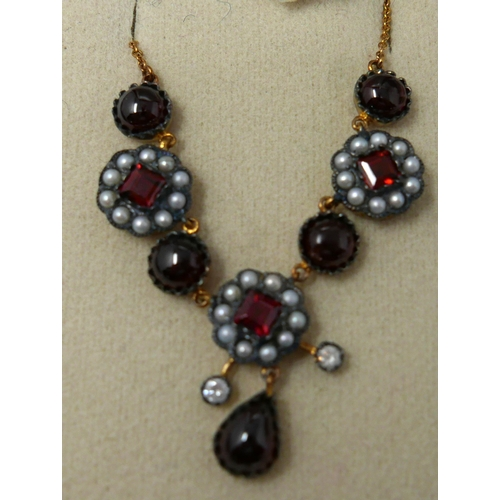 23 - A boxed yellow gold, diamond, seed pearl and garnet cluster necklace, L: 48cm, 6.7g...