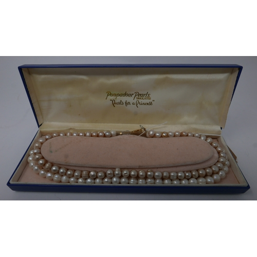 49 - A boxed, double strand freshwater pearl necklace, L.48cm...