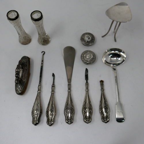 57 - A collection of antique silver items to include a ladle, 18cm, a Victorian nail buffer, silver-handl...