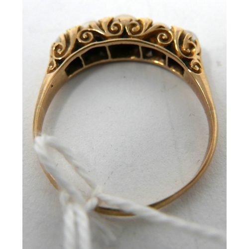 52 - A Victorian 18ct yellow gold graduated 5 pearl and diamond ring, to a hand-carved scrolling mount, S...