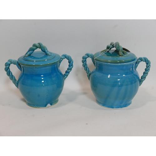 116 - A pair of Persian cyan glazed jars and covers, with rope twist design handles, H.26 W.28cm...
