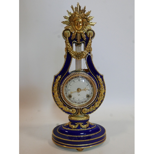 127 - A V&A Marie Antoinette style clock by Franklin Mint, H.39cm...