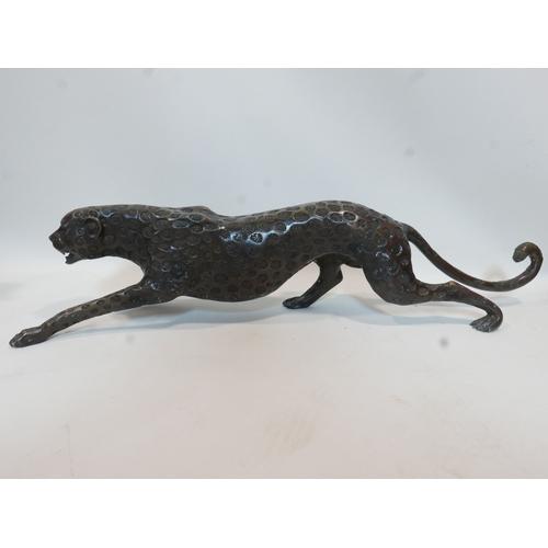 17 - A cast bronze leopard, H.23 W.108 D.23cm
