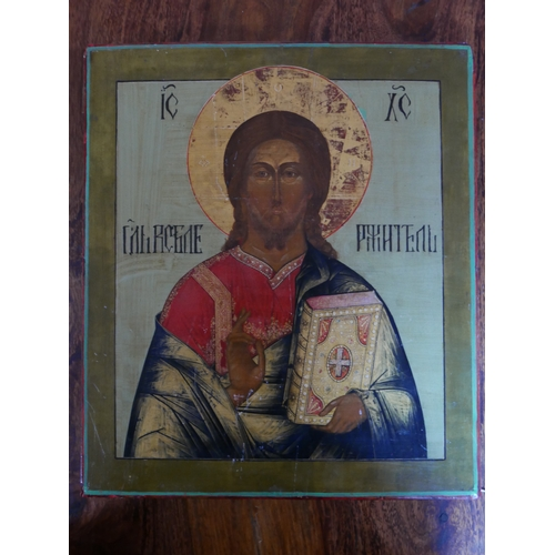 41 - A Russian icon of Christ Pantocrator, tempera on wood panel, with Cyrillic inscription to verso, 36 ...