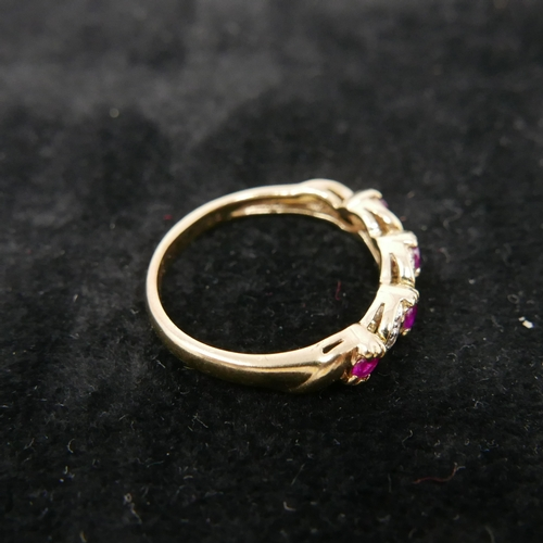 59 - A boxed 9ct yellow gold ring set with 4 round faceted rubies inter-spaced by diamonds, Size: K 1/2, ...