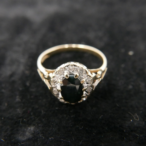 78 - A boxed 9ct yellow gold diamond and sapphire cluster ring, Size: L 1/2, 2g.