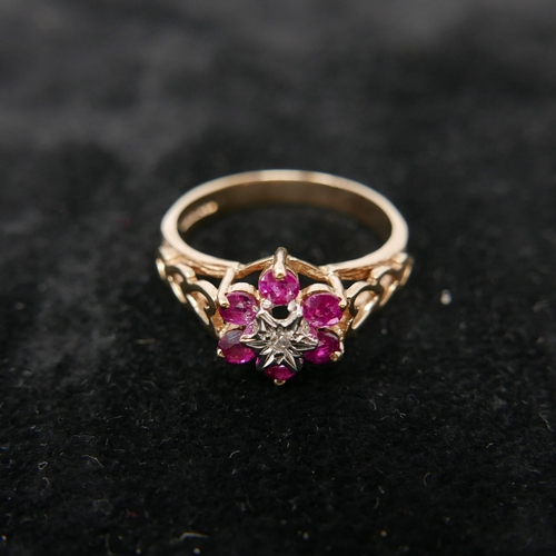 92 - A boxed 9ct yellow gold diamond and ruby flower-cluster ring to pierced heart-shaped shoulders, Size...