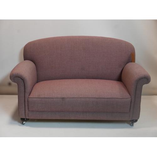 195 - An early 20th century drop end sofa raised on bun feet and castors...