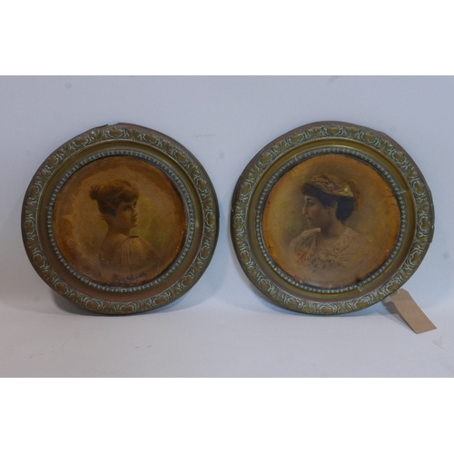 413 - A pair of Victorian brass and paper mache plaques...