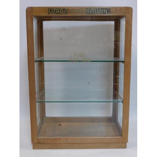 122 - A vintage glass shops display cabinet for Fords gold medal blotting, H.75 W.52 D.34cm...
