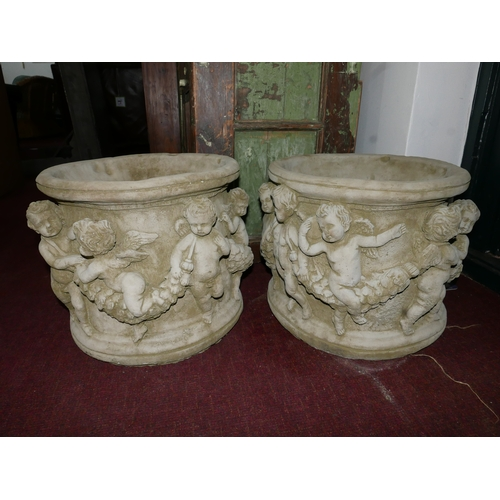 210 - Two reconstituted stone pots, decorated with a procession of cherubs and floral swags, H.32cm Diamet...