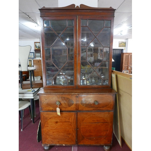 229 - A Regency mahogany and boxwood inlaid secretaire bookcase, two glazed doors over fitted desk, above ...