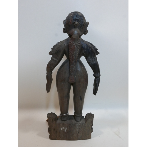 300 - A South East Asian carved hardwood figure, H.40cm...