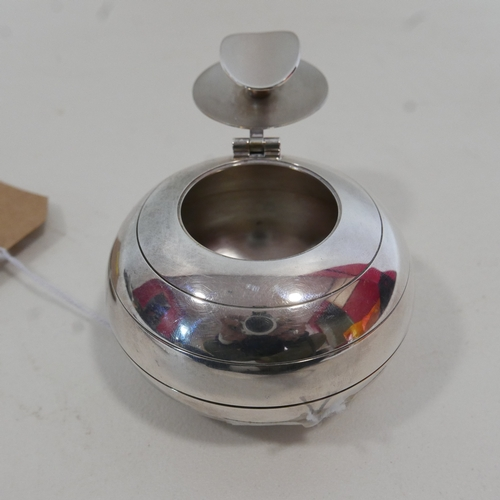 114 - A Christofle silver plated ashtray of ovoid form, marked to base, the hinged lid with knopped finial...