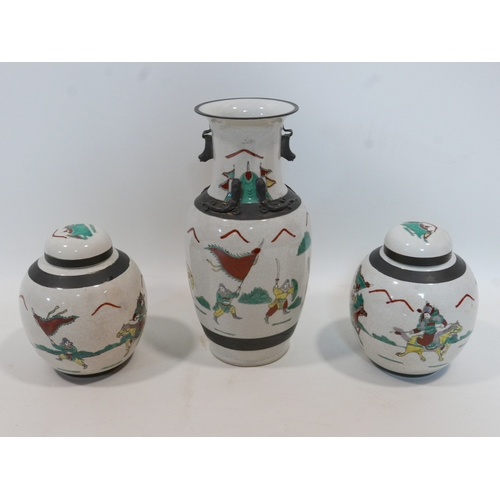 206 - A late 19th/early 20th century Chinese crackle glazed vase and matching pair of ginger jars, decorat...
